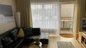 Das Wohnzimmer und Balkon, Ferienwohnung Witthöhn